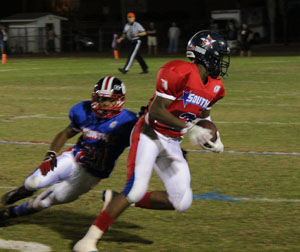 Tajee Fullwood sprints upfield with a pass from Deiondre Porter - Fullwood won the South MVP award