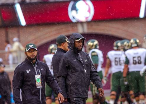USF Head Coach Willie Taggart in rain gear at FSU 2015 DL (2400x1711)