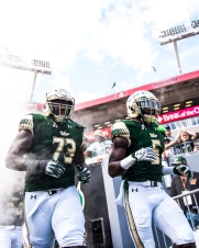 30 USF vs ECU 2016 - USF OL Jeremi Hall and RB Marlon Mack exiting the tunnel (3086x3857)
